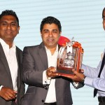 Caption for PHOTO : Executive Chairman and Managing Director of the Epic Technology Group Dr. Nayana Dehigama presents a memento to Chief Operating Officer of the Sampath Bank Mr. Nanda Fernando. The Sampath Bank goes on record as being the first-ever customer of the 'Access Control Server Solution. Also in the picture is Director/CEO of the Epic Technology Group and chief architect of this product, Mr. Viraj Mudalige